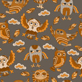 Seamless illustration with owls and leaves in a brown tone Royalty Free Stock Photos