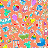 Seamless illustration  on the theme of childhood and newborn babies, baby accessories and toys, simple color patches icons on oran. Seamless pattern on the theme Royalty Free Stock Photography