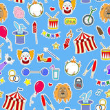 Seamless illustration on the theme of circus, simple colored icons patches on a blue background. Seamless pattern on the theme of circus, simple colored icons Stock Image