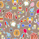 Seamless illustration  on the theme of circus, simple colored icons patches on a brown background. Seamless pattern on the theme of circus, simple colored icons Royalty Free Stock Photography
