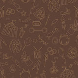 Seamless illustration  on the theme of circus, simple contour icons, ,beige contour on brown background. Seamless pattern on the theme of circus, simple contour Royalty Free Stock Images