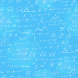 Seamless illustration  on the theme of the subject of geometry , formulas, and charts of theorems , a bright outline on a blue  ba. Seamless pattern on the theme Royalty Free Stock Photography
