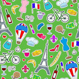 Seamless illustration on the theme of travel in the country of France, simple icons patches, the coloured symbols on a green backg. Seamless pattern on the theme Royalty Free Stock Photos