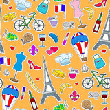 Seamless illustration on the theme of travel in the country of France, simple icons patches, the coloured symbols on a orange back Stock Photo