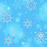 Seamless illustration on the theme of winter and winter holidays, the contour of the snowflake and flare, white snowflakes on a bl. Seamless pattern on the theme Royalty Free Illustration