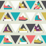 Seamless illustration with triangles and sport sneakers shoes in seamless pattern in bright colors. Lowpoly design for fash. Ion purposes. Women footwear in pink vector illustration