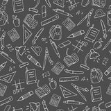 Seamless image with a simple contour icons on a theme school , a bright outline on a dark background. Seamless pattern on the theme of the school, a simple Stock Image