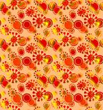 Seamless intricate floral pattern red yellow orange. Abstract geometric background, seamless floral circles pattern with yellow, orange and red elements on peach Stock Image