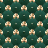 Seamless irish gold pattern with clover and heart on a dark green background. Pattern for St. Patrick Day. Vector Illustration. Royalty Free Stock Photos