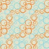 Seamless irregular circles diagonal. Blue and orange irregular circles on a diagonal distribution Royalty Free Stock Photos