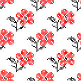 Seamless isolated texture with abstract red embroidered flowers with leaves for cloth. Embroidery. Cross stitch. Royalty Free Stock Photos
