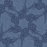 Seamless jeans background with black floral pattern. Stock Image