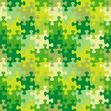 Seamless jigsaw puzzle pattern of spring, summer or camouflage colors. Seamless you see 4 tiles jigsaw puzzle pattern, background, print, swatch or wallpaper Royalty Free Stock Image
