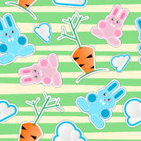 Seamless kid pattern with bunnies, clouds, carrots Stock Images