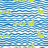 Seamless kids pattern with funny cartoon swimming mother duck and ducklings in water. Stock Photography