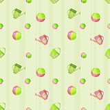 Seamless kids pattern with watering cans and balls on striped Royalty Free Stock Image