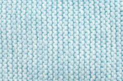Knitted wool scarf fabric texture background. Seamless knitted blue and white wool scarf background. Neutral winter fabric  texture Stock Photos