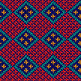 Seamless knitted colorful rhombus pattern. Rhombus checkered knitted background in red, blue, orange and turquoise colors, seamless knitting vector pattern as a Royalty Free Stock Photo