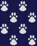 Seamless knitted dog paw seamless pattern blue white vector illustration vector illustration