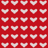 Seamless knitted heart. Seamless pattern with  a white heart on knitted red background Royalty Free Stock Photos