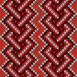 Seamless knitted interwoven pattern in warm hues Royalty Free Stock Photo