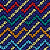 Seamless knitted multicolor wavy pattern. Knitted wavy multicolor background in red, blue, beige, orange and turquoise colors, seamless knitting vector pattern stock illustration