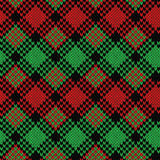 Seamless knitted pattern in black, green and red colors. Knitted seamless vector pattern in black, green and red colors with quadratic elements as a fabric Royalty Free Stock Photo