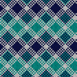 Seamless knitted pattern in blue, turquoise and white colors. Knitted seamless vector pattern in blue, turquoise and white colors with quadratic elements as a Stock Photos