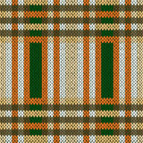 Seamless knitted pattern in brown, green and white Stock Photo