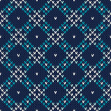 Seamless Knitted Pattern. Festive and Fashionable Sweater Design. Seamless pattern ornament on the wool knitted texture. EPS available Royalty Free Stock Photo