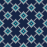 Seamless Knitted Pattern. Festive and Fashionable Sweater Design. Seamless pattern ornament on the wool knitted texture. EPS available Stock Photography