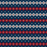 Seamless Knitted Pattern. Festive and Fashionable Sweater Design. Seamless pattern ornament on the wool knitted texture. EPS available Stock Images