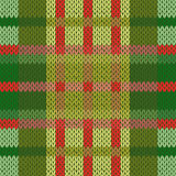 Seamless knitted pattern in green and red hues Stock Photography