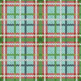 Seamless knitted pattern in green, red and white hues Stock Photo