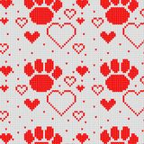 Seamless Knitted Pattern with heart and dog paw Background. Knitting Sweater Design Royalty Free Stock Images