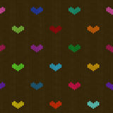 Seamless knitted pattern with hearts Stock Images