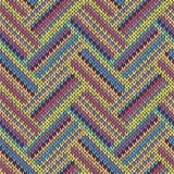 Seamless knitted pattern. Multicolored repeating tribal template. Royalty Free Stock Photos