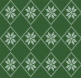Seamless knitted pattern in nordic style with white snowflakes o Stock Photo