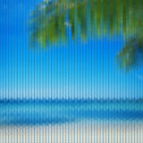 Seamless knitted pattern with palm branch and blue sea Royalty Free Stock Photography