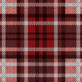 Seamless knitted pattern in red and brown hues Stock Images