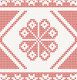 Seamless knitted pattern with red flower Royalty Free Stock Images