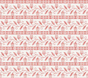 Seamless knitted pattern with red flower Royalty Free Stock Photos