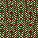 Seamless knitted pattern in red, green and beige colors Stock Images