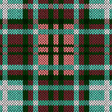Seamless knitted pattern in red, green, turquoise and white Royalty Free Stock Photos