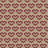 Seamless knitted pattern with red hearts Stock Photography
