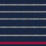 Seamless knitted pattern with red white stripes Royalty Free Stock Images
