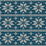 Seamless knitted pattern with snowflakes Royalty Free Stock Image