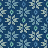 Seamless knitted pattern with snowflakes Royalty Free Stock Photography