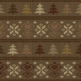 Seamless knitted pattern with trees and snowflakes Royalty Free Stock Images