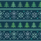 Seamless knitted pattern with trees and snowflakes Stock Image